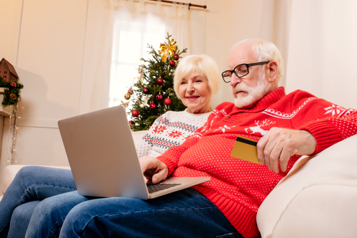 Older couple shopping online